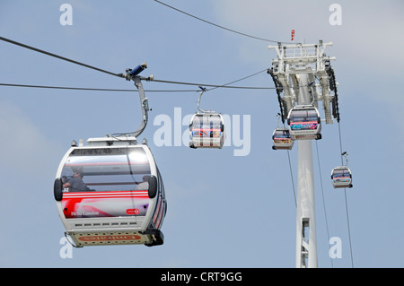 Emirates Air Line sponsored cable car service crossing the River Thames between Greenwich Peninsula and Royal Docks - Stock Photo