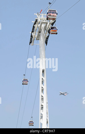 Emirates Air Line sponsored cable car service crossing River Thames between Greenwich Peninsula & Royal Docks (not - Stock Photo