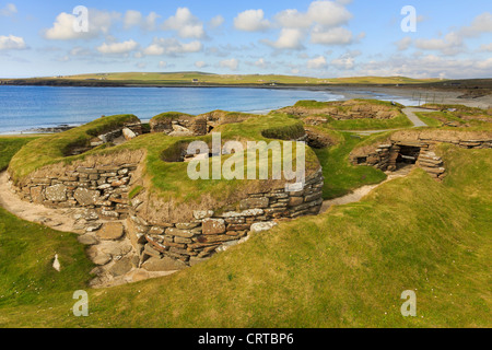 Excavations of ancient prehistoric houses in Neolithic village at Skara Brae by Bay of Skaill Orkney Islands Scotland - Stock Photo