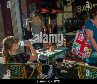 Paris, Cafe, France, French Female Teenage Binge Drinking laying on Sidewalk Table at Gay Pride (LGBT) - Stock Photo