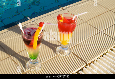 two cocktails near swimming pool - Stock Photo