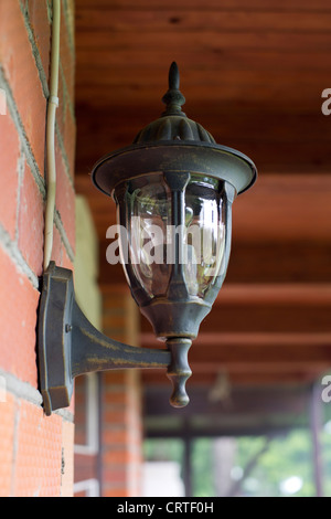 Lamp in retro style on red brick wall - Stock Photo