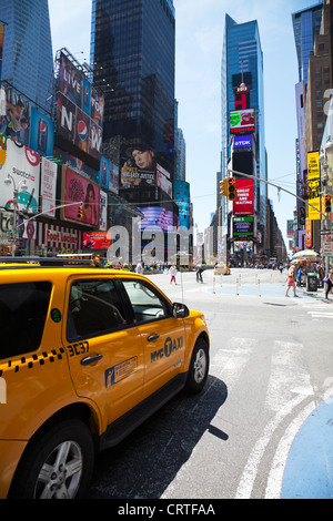 The iconic yellow taxi cab in Times Square, New York city USA. buildings modern cities.Times square new York,times - Stock Photo