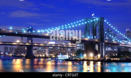 Brooklyn Bridge and Manhattan Bridge spanning the East River towards Brooklyn in New York City. - Stock Photo