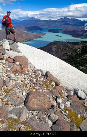 Hiker above Lago Nordenskjold in Torres del Paine National Park - Stock Photo