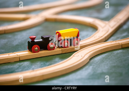 Toy wooden train set on wooden track - Stock Photo
