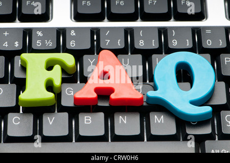 FAQ concept with letters on keyboard Stock Royalty Free
