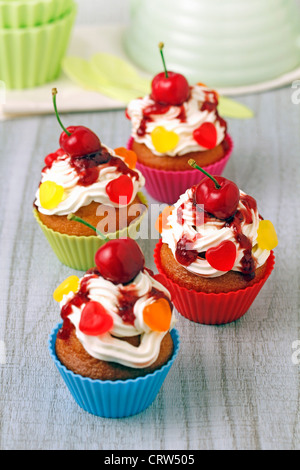 Cupcakes with cherries. Recipe available - Stock Photo