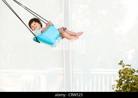 boy swinging - Stock Photo