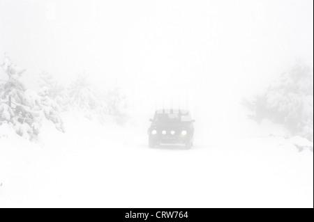 Heavy snow on the road - Stock Photo