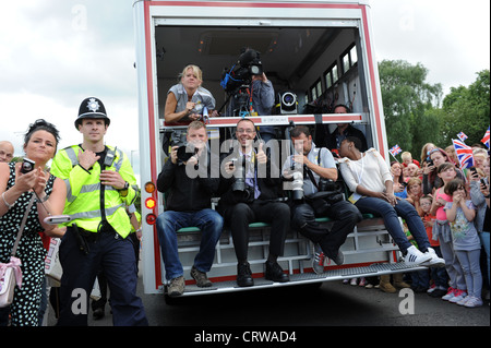 Photographers and video crews filming the Olympic Torch relay through the West Midlands - Stock Photo
