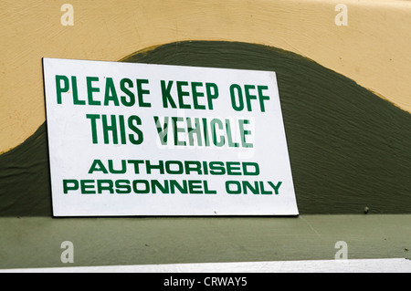 Sign on a military vehicle 'Please keep off this vehicle, Authorised personnel only' - Stock Photo