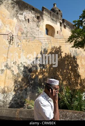 Muslim man visiting Fort Jesus in the old town in Mombasa, Kenya - Stock Photo