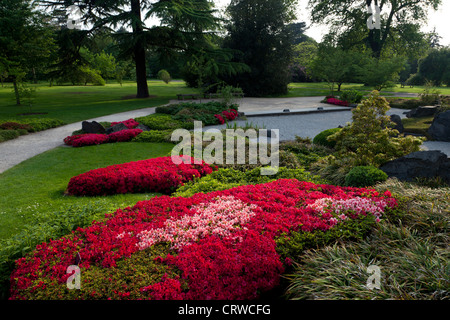 Flowerbeds and trees at a section of Kew Garden in London in England. - Stock Photo