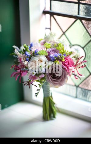 wedding bouquet of flowers near a window - Stock Photo