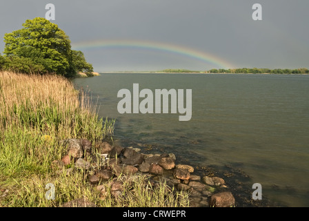 Rainbow about the Schlei - Stock Photo