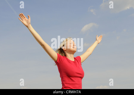 young woman spreads her arms - Stock Photo