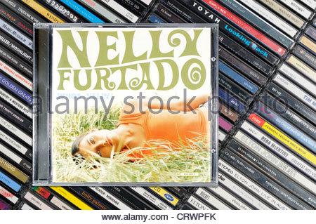 Nelly Furtado album, Whoa Nelly piled music CD cases, England. - Stock Photo