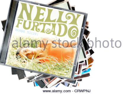 Nelly Furtado album, Whoa Nelly piled music CD cases, England. - Stock Photo