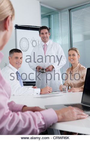 Portrait of engineer and business people meeting in conference room - Stock Photo