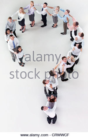 Portrait of business people forming question mark - Stock Photo