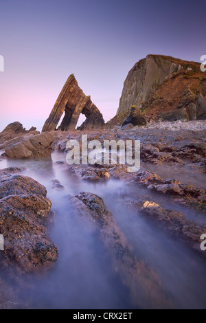 Blackchurch Rock and rocky ledges at twilight, Mouthmill Beach, North Devon, England. Winter (January) 2010. - Stock Photo