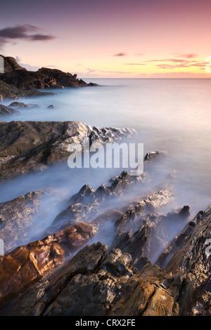 Rocky coast at Sunset, Leas Foot Sand, Thurlestone, South Hams, Devon, England. Winter (January) 2010. - Stock Photo