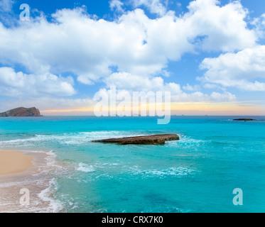 Ibiza Cala Conta Comte Compte sunset with bledas islands in horizon - Stock Photo