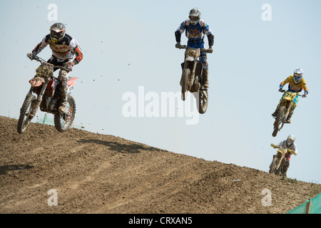 Four unidentified riders jump during race 1 at the Motocross World Championship MX3 on July 1, 2012 in Senkvice, - Stock Photo