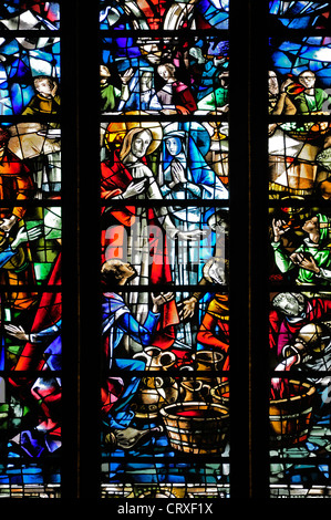 Liege, Belgium. Cathedrale St Paul. Modern Stained glass window. Wedding at Cana - Jesus turning water into wine - Stock Photo
