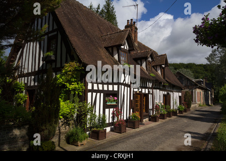 Architecture in the Rue des Trois Moulins, Lyons-la-Forêt, Normandy, France - Stock Photo