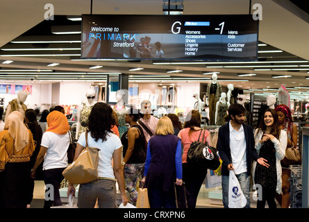 Shoppers outside the Primark store, westfield shopping centre mall, Stratford London UK - Stock Photo
