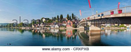 Switzerland, Stein am Rhein, View of bridge with flag and flower pot over River Rhine - Stock Photo