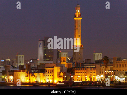 The skyline of the old city of Dubai in the evening light - Stock Photo