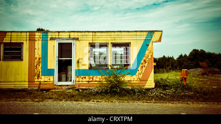 An abandoned, colorful yellow trailer near Rostraver, Pennsylvania - Stock Photo