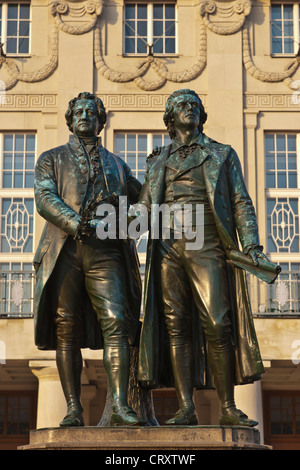 Germany, Thuringia, Weimar, View of Goethe-Schiller monument in front of German National Theatre - Stock Photo