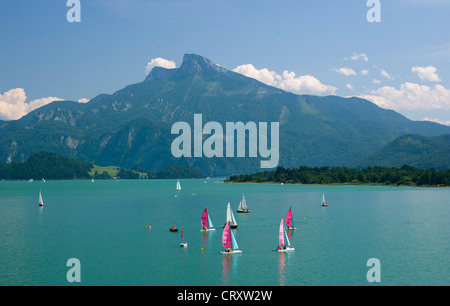Austria, View of sailing boat in Mondsee Lake - Stock Photo