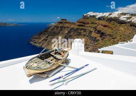 Santorini, Weathered wooden boat on balcony - Stock Photo