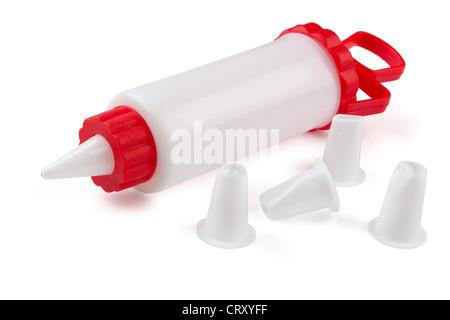 Cake decoration icing syringe and set of nozzles isolated on white - Stock Photo