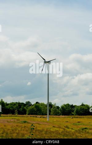 Small Wind Turbine in field - Stock Photo