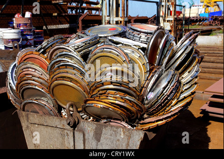 The scrap metal is combined in the container for transportation - Stock Photo