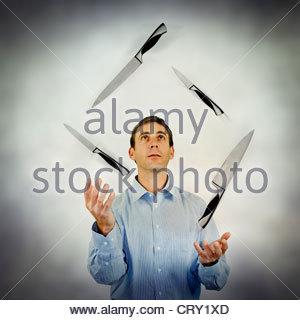 knife juggling - Stock Photo
