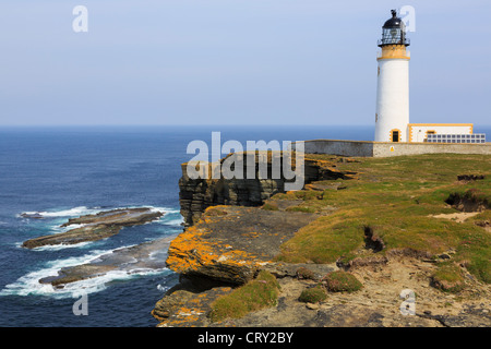 Noup Head lighthouse built on headland seacliffs to warn ships off North Shoal on Westray Island Orkney Islands - Stock Photo