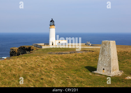 Trig point and lighthouse built on headland to warn ships off North Shoal at Noup Head, Westray Island, Orkney Islands, - Stock Photo
