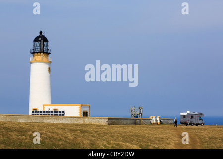 Motorhome by lighthouse built on headland to warn ships off North Shoal at Noup Head Westray Island Orkney Islands - Stock Photo