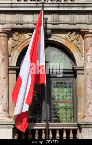 The flag of Antwerp flying high over the town hall of Antwerp, Belgium - Stock Photo
