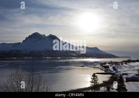 View across Tromso Sound to Tromso and the Lyngen Alps from Kvaloya Island in Arctic Circle Northern Norway - Stock Photo