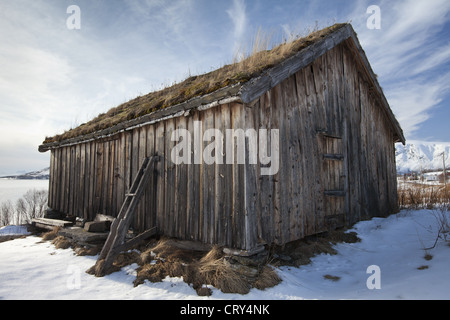 Straumengard Museum in log cabin at Straumsfjord on Kvaloya Island near Tromso in Arctic Circle Northern Norway - Stock Photo