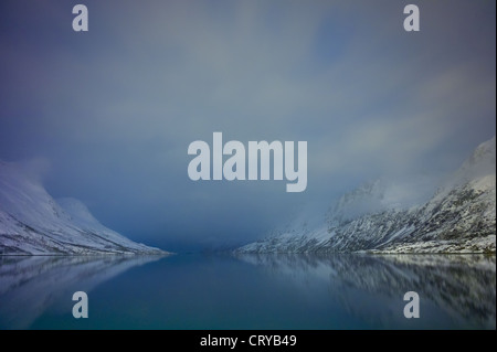 Arctic sky and landscape at Ersfjordbotn on Klavoya Island near Tromso, Northern Norway - Stock Photo