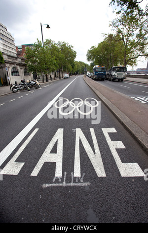 Olympic Games Lanes on Victoria Embankment for athletes and officials to avoid traffic congestion during London - Stock Photo